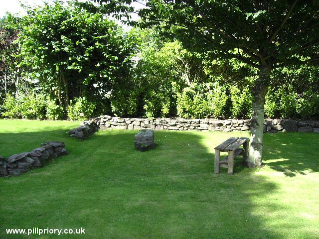 Pill priory, site of burials, NE of the chancel arch